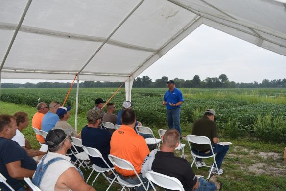 This image shows agronomist Nate Prater talking to growers about soybean burndown herbicide application.