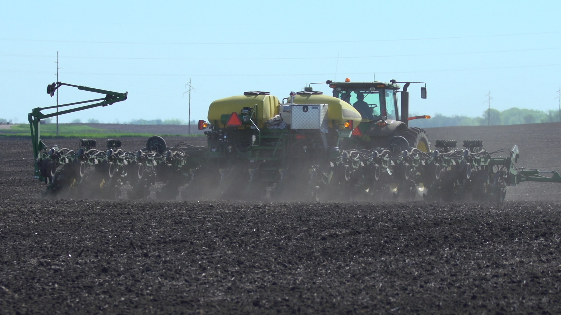 This agronomic image shows a seed planter